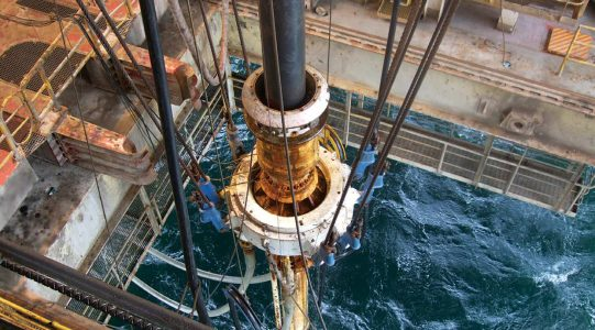 Oil well drill looking down into the sea